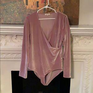 Pale pink velvet bodysuit from Madewell.